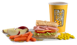 Kids meal featuring kids sandwich, small drink, carrots and apple slices